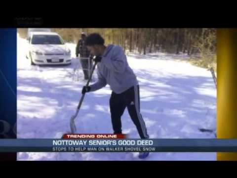Teen helps elderly man shovel the driveway