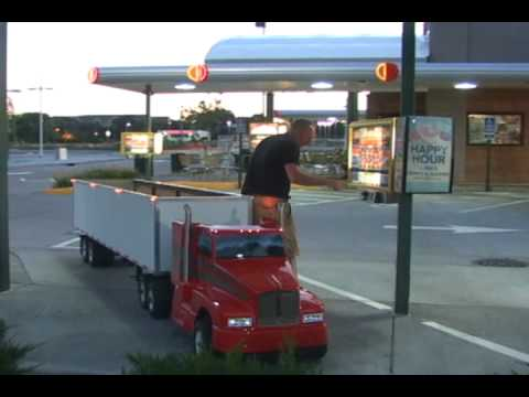 Driving down the street in the… mini-truck!!!
