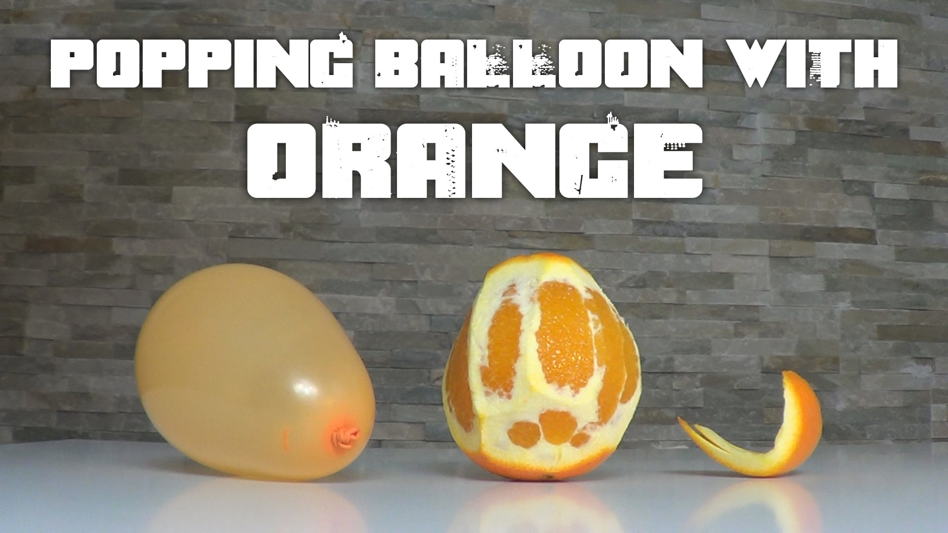 Popping a balloon with… an orange!!!