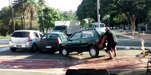 WATCH: Furious Man Lifts Car Out of Bike Lane then Rides Off Peacefully