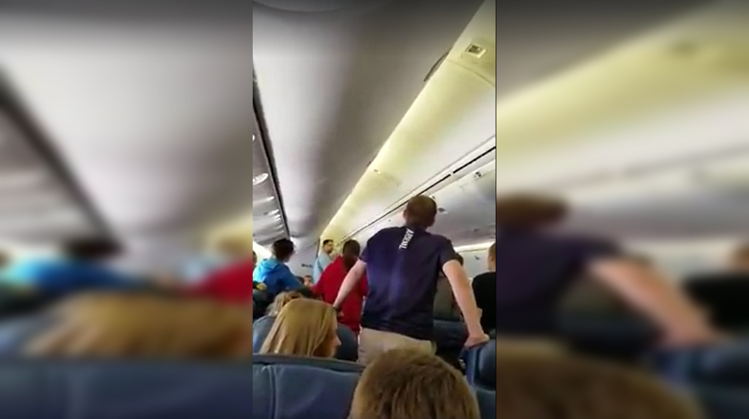 Soldier About To Exit Plane With Remains Of Fallen Hero, Student Passengers Stand In Impromptu Song