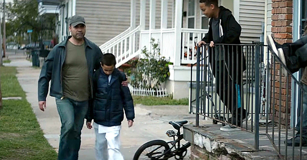 Dad Walks With Frightened Son, Bullies Don't Realize What's Under His Coat